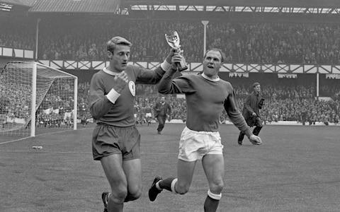 "It remains perhaps the most iconic photograph in the history of British sport. England captain Bobby Moore is holding aloft the Jules Rimet trophy while on the shoulders of Sir Geoff Hurst and Ray Wilson after England had won the 1966 World Cup at Wembley. Wilson, who was 83, on Wednesday became the third member of that team to die after Moore and Alan Ball following what has been a 14-year battle with Alzheimer's disease. The left-back and oldest member of Sir Alf Ramsey's iconic team, Wilson was not well enough to attend the 50th anniversary dinner two years ago, but had been living with his wife Pat in Yorkshire and regularly attending matches at Huddersfield Town with his two sons, Russell and Neil. News of Wilson's death emerged just as Gareth Southgate named his England squad for the forthcoming World Cup in Russia and, 52 years on, just simply the passage of time remains sufficient to underline the magnitude of what Wilson helped to achieve. Tributes poured in for a player who never courted the limelight and was among the lesser known of England's World Cup-winning team, but was regarded by many good judges as the best left-back of his time and the finest in English history. ""In many people's eyes, the best English left-back ever,"" said Jimmy Greaves. ""We had some laughs and late nights through the years and even with your illness you carried on coming with us and keeping us on our toes until about six years ago. Goodbye old friend."" Ray Wilson (right) celebrates with the Jules Rimet trophy alongside Bobby Moore (left) and Jack Charlton (centre) Credit: PA Sir Bobby Charlton said he was ""deeply saddened by the awful news"", describing Wilson as ""a great man, an excellent team-mate and a close friend"". Wilson was born in Shirebrook, a Derbyshire mining village in 1934, and was working on the railways when he was signed by Huddersfield at the age of 18. It was there that he was converted from wing-half to full-back by Bill Shankly, then Huddersfield manager, and he broke into the England team from the second tier of English football. Wilson was one of the first of the modern and more mobile full-backs who could influence both ends of the pitch, and this mobility helped to inspire Ramsey's 'Wingless Wonders' system. At the time, most full-backs were physical defenders, but Wilson could match opposing wingers for pace, skill and vision. Ray Wilson (top row, second right) with the England World Cup-winning team Credit: HULTON ARCHIVE He was also selected in the 1962 World Cup squad in Chile and, by the time he had moved to Everton in 1964, he was established in Ramsey's England team. During the 1966 finals, Wilson was ever-present, providing the incisive pass which allowed Martin Peters to create Hurst's winner in the quarter-final against Argentina before reaching his 50th cap in the semi-final against Portugal. In the final, his early header fell to Bologna striker Helmut Haller, who duly put West Germany into a 12th-minute lead, but he was among England's best performers thereafter in the eventual 4-2 victory. Wilson would later joke that he was grimacing in pain in the photograph with Moore as he was shouldering most of his team-mate's weight and a bronze statue of the four players – Moore, Hurst, Peters and Wilson – stands just yards from West Ham's old Upton Park stadium. He later also played at Oldham Athletic and Bradford City, where he spent a short period coaching, before working as an undertaker and living just outside Huddersfield in Slaithwaite. As with so many of the 1966 team, the authorities were slow to celebrate Wilson's achievements. He received an MBE some 34 years after the World Cup win and was inducted into English football's Hall of Fame in 2008. He sold his World Cup-winning medal in 2002 for £80,750 after deciding it was better to share the funds between his children, rather than simply leave it as a memento. Ray Wilson slides in to take the ball away from France's Philippe Gondet in 1966 Credit: HULTON ARCHIVE Wilson was only 69 when he was diagnosed with dementia in 2004. His England team-mates Nobby Stiles and Peters are also suffering with the disease, while Jack Charlton has been experiencing problems with his memory. Numerous other former footballers have been diagnosed with various neurological diseases at a worryingly young age and, following a Telegraph campaign, the Football Association and the Professional Footballers' Association are now funding a research project into the potential link with football. It is, though, 16 years since former England international, Jeff Astle, died from a type of dementia – chronic traumatic encephalopathy – that is caused by head trauma. World Cup winners Roger Hunt, left, and Ray Wilson of Liverpool and Everton, champions and FA Cup-winners respectively, show the Jules Rimet trophy a fortnight after England's victory to the Goodison crowd before the Charity Shield Credit: PA Photos In recent interviews, Wilson's family have described how he remained happy even during his illness and spent much of his later years drawing and walking their dogs. The unexpected passion for art was prompted when his son's partner bought him a colouring book and he has sketched thousands of detailed pictures of fantastical creatures on A4 sheets of card. For their promotion-winning 2016-17 season, Huddersfield released a new second-change kit in Wilson's honour. It was designed with the tag line 'Legends Are Rarely Made' and, 50 years on from England's greatest football triumph, was in the same red of the 1966 World Cup winning kit. The kit had Wilson's signature in white, beneath the collar on the back, and below the white badge on the front. An old pair of his football boots are also on display in the boardroom. Joe Royle, who made his Everton debut in the same year that Wilson helped them also win the FA Cup at Wembley in 1966, said last night that Wilson had played ""in the last England team that had four, maybe five, world class players"". He added that Wilson ""was certainly one of those - a maestro"". When poised to win his 100th cap, Steven Gerrard explained even more succinctly how Wilson shared the most elevated possible platform in English football. ""Hero status is given out far too easily,"" he said. ""As far as playing for England goes, there are 11 heroes. The rest haven't really delivered."""