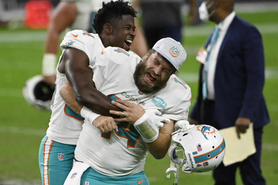 Miami Dolphins wide receiver Isaiah Ford, left, celebrates with quarterback Ryan Fitzpatrick after defeating the Las Vegas Raiders. (AP Photo/David Becker)