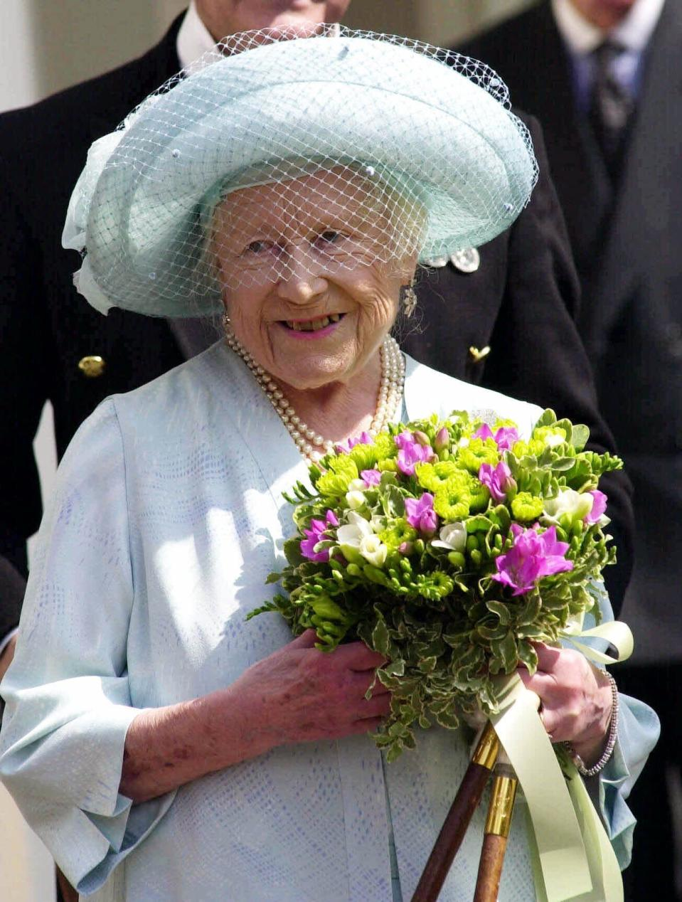 FILE - In this Friday, Aug. 4, 2000 file photo, Britain's Queen Elizabeth, The Queen Mother appears at the main gates to Clarence House, in London, before taking the Salute on her 100th birthday. Prince Philip was the longest serving royal consort in British history. In Britain, the husband or wife of the monarch is known as consort, a position that carries immense prestige but has no constitutional role. The wife of King George VI, who outlived him by 50 years, was loved as the Queen Mother. (Rebecca Naden/pool via AP, File)