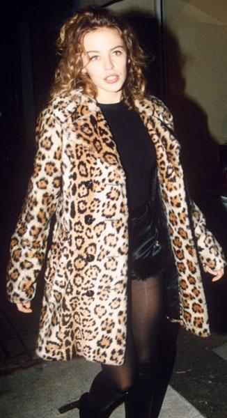 <b>Kylie at the Jean Paul Gaultier store opening in London, 1991</b><br><br>Showing that leopard print never truly goes out of style, Kylie wore this oversized fur jacket for the store launch in the capital.