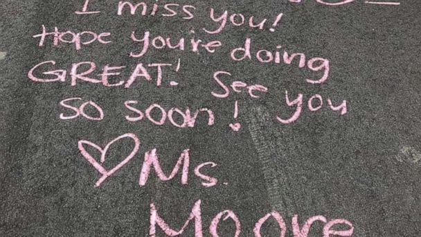 PHOTO: Two teachers from Rosemount Apple Valley Eagan Public Schools visited the kids from their class and wrote chalk messages. (Rosemount Apple Valley Eagan Public Schools )