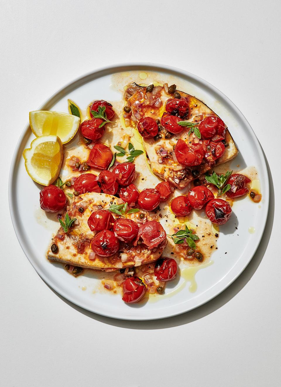 "Swordfish, with its meaty texture and strong (not in a bad way) flavor, can stand up to other robust seasonings like these. In its place, choose another firm-fleshed type, such as cod, halibut, or salmon. <a href=""https://www.bonappetit.com/recipe/swordfish-steaks-cherry-tomatoes-capers?mbid=synd_yahoo_rss"" rel=""nofollow noopener"" target=""_blank"" data-ylk=""slk:See recipe."" class=""link rapid-noclick-resp"">See recipe.</a>"