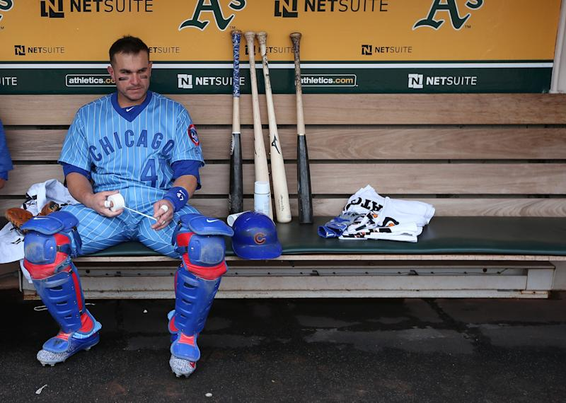 Miguel Montero #47 of the Chicago Cubs gets ready in the dugout before the game against the Oakland Athletics at the Oakland Coliseum on Saturday, August 6, 2016 in Oakland, California.
