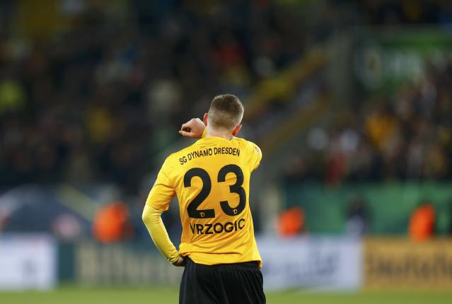 Dynamo Dresden's David Vrzogic reacts following his team's defeat by Borussia Dortmund in their German Cup (DFB Pokal) soccer match in Dresden March 3, 2015. REUTERS/Hannibal Hanschke (GERMANY - Tags: SOCCER SPORT) DFB RULES PROHIBIT USE IN MMS SERVICES VIA HANDHELD DEVICES UNTIL TWO HOURS AFTER A MATCH AND ANY USAGE ON INTERNET OR ONLINE MEDIA SIMULATING VIDEO FOOTAGE DURING THE MATCH.