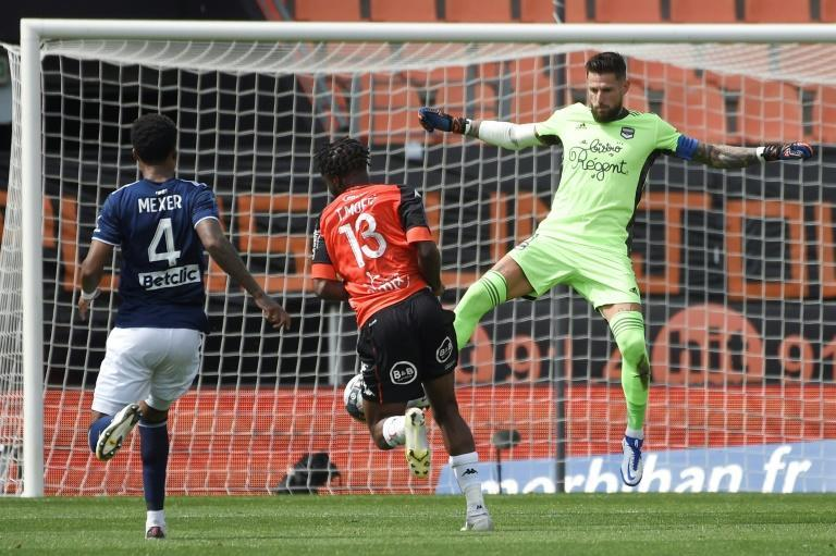Nigerian striker Terem Moffi (C) scored a hat-trick to move Lorient four points clear of the relegation play-off place