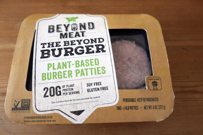 FILE - In this June 26, 2019, file photo, a package of meatless burgers are seen in Orlando, Fla. In a very limited test in Canada, McDonald's said Thursday, Sept. 26, that it's introducing the PLT, or the plant, lettuce and tomato burger. It will be available for 12 weeks in 28 restaurants in Southwestern Ontario by the end of the month. (AP Photo/John Raoux, File)