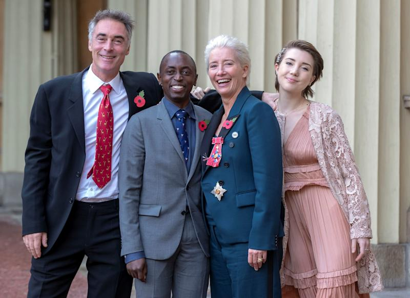 Emma Thompson and her family at Buckingham Palace.  (STEVE PARSONS via Getty Images)