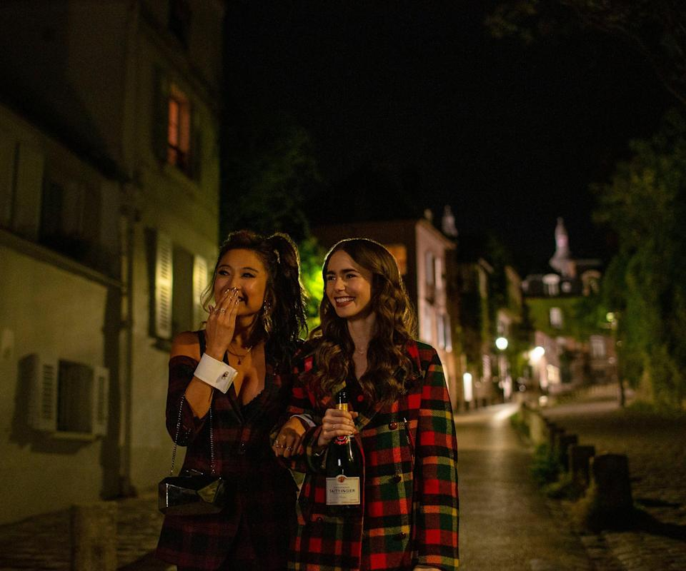 """<h3>Episode 5: """"Faux Amis""""</h3><br><strong>What Emily's Up To: </strong>Her Instagram account @emilyinparis is growing rapidly and turning Emily into a bonafide influencer. Her boss is threatened by that and tells Emily to take the page down until she realizes that it could help their clients — not hurt them.<br><br><strong>Where Emily Goes:</strong> She gets breakfast with Mindy at <a href=""""https://www.yelp.com/biz/le-caf%C3%A9-de-la-nouvelle-mairie-paris"""" rel=""""nofollow noopener"""" target=""""_blank"""" data-ylk=""""slk:Café De La Nouvelle Mairie"""" class=""""link rapid-noclick-resp"""">Café De La Nouvelle Mairie</a>, which is right by her apartment and across the street from Gabriel's restaurant. She also heads to an influencer event at <a href=""""https://en.convention.parisinfo.com/paris-professional/74546/Hotel-d-Evreux"""" rel=""""nofollow noopener"""" target=""""_blank"""" data-ylk=""""slk:Hotel d'Evreux"""" class=""""link rapid-noclick-resp"""">Hotel d'Evreux</a> and goes to a Van Gogh exhibit at the avant-garde museum <a href=""""https://www.atelier-lumieres.com/"""" rel=""""nofollow noopener"""" target=""""_blank"""" data-ylk=""""slk:Atelier des Lumières"""" class=""""link rapid-noclick-resp"""">Atelier des Lumières</a>. <br> <br>Later, Emily grabs drinks with Mindy for an Instagrammable night to remember at <a href=""""https://www.yelp.com/biz/la-maison-rose-paris"""" rel=""""nofollow noopener"""" target=""""_blank"""" data-ylk=""""slk:La Maison Rose"""" class=""""link rapid-noclick-resp"""">La Maison Rose</a>, and the two walk down """"the prettiest street in Paris."""" Mindy calls this road """"Ruelle Qui Va Au Bout,"""" which means """"the road which leads to the end."""" But in real life the street is called """"Rue de l'Abreuvoir,"""" and it has indeed been called one of the <a href=""""https://www.solosophie.com/must-see-pretty-paris-streets/"""" rel=""""nofollow noopener"""" target=""""_blank"""" data-ylk=""""slk:prettiest streets in Paris"""" class=""""link rapid-noclick-resp"""">prettiest streets in Paris</a>. <span class=""""copyright"""">Photo: Courtesy of Netflix.</span>"""