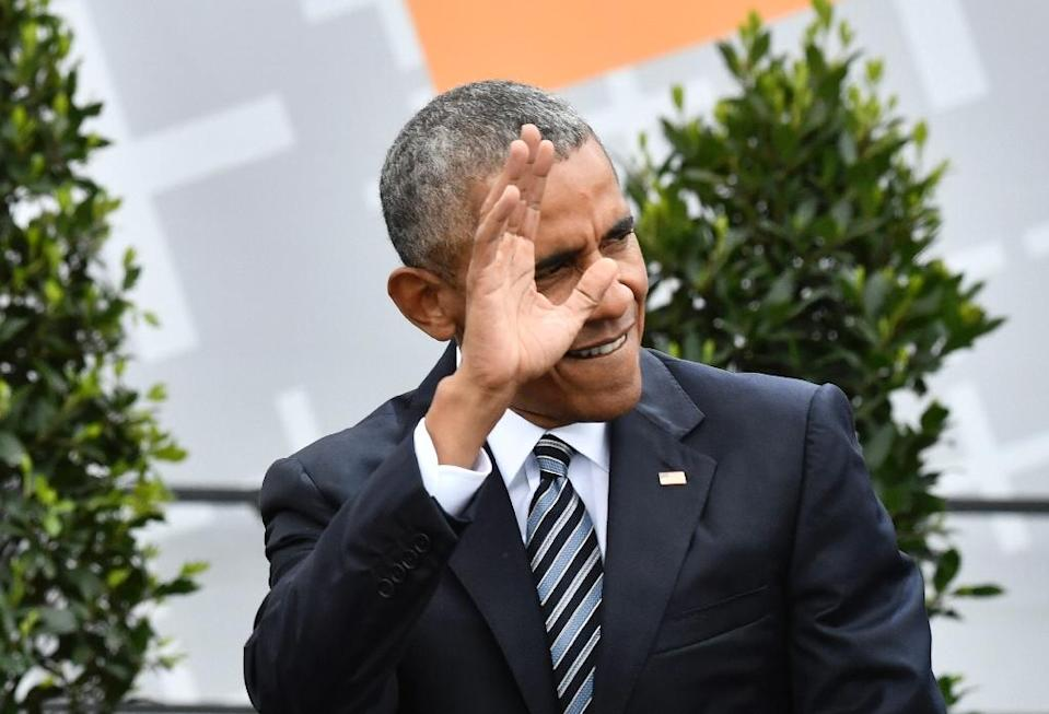 Former US president Barack Obama, seen here in Germany in May 2017, has largely kept silent as Trump moves to undo his legacy (AFP Photo/John MACDOUGALL)