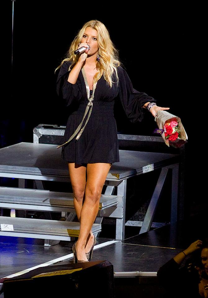 "Jessica Simpson flaunted her curvier figure during a performance at Madison Square Garden Thursday. ""I've had times when my pants split right down the middle when I bent down to reach a note,"" the singer revealed. ""That's why I'm wearing a skort -- not a skirt, not a short -- just so they wouldn't split."" NYC JS/<a href=""http://www.splashnewsonline.com"" target=""new"">Splash News</a> - February 12, 2009"