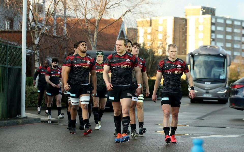 Saracens walk from the changing rooms to the pitch during the Trailfinders Challenge Cup match between Ealing Trailfinders and Saracens at the Trailfinders Sports Club - GETTY IMAGES