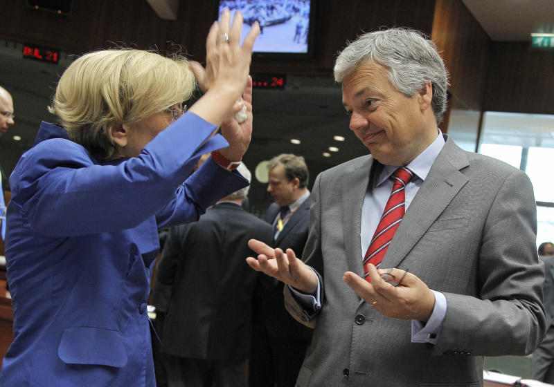 Belgium's Foreign Minister Didier Reynders, right, talks with Italy's Foreign Minister Emma Bonino, during the EU foreign ministers meeting, at the European Council building in Brussels, Monday, July 22, 2013. European Union foreign ministers were set Monday to tackle the thorny question of whether Hezbollah's military wing should be blacklisted as a terrorist organization, at a meeting in Brussels that is also due to feature talks on Egypt and Syria. (AP Photo/Yves Logghe)