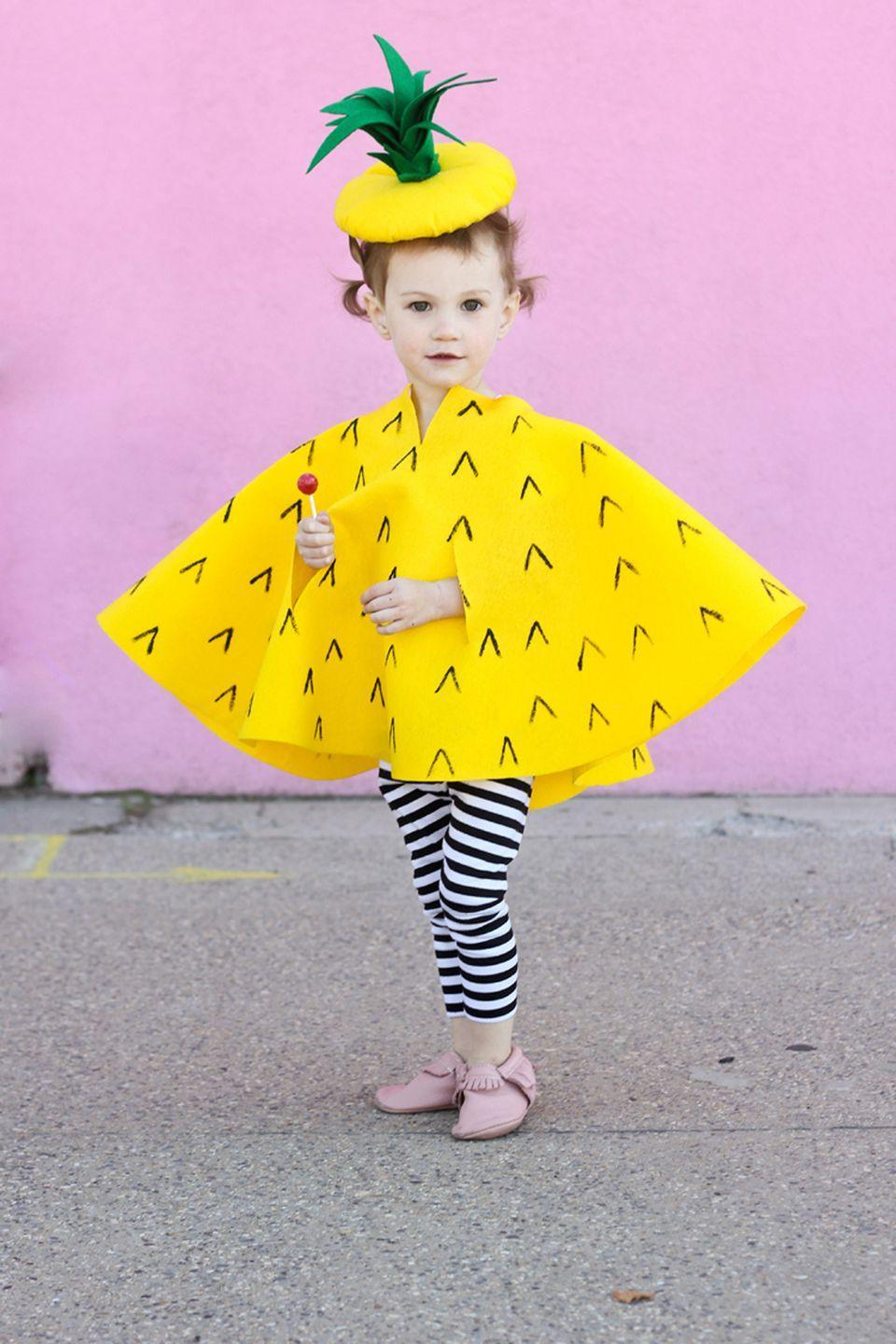 """<p><span>Her favorite fruit now comes in costume form. </span></p><p><strong>Get the tutorial at <a href=""""http://www.deliacreates.com/no-sew-pineapple-halloween-costume/"""" rel=""""nofollow noopener"""" target=""""_blank"""" data-ylk=""""slk:Delia Creates"""" class=""""link rapid-noclick-resp"""">Delia Creates</a>.</strong><br></p><p><strong><a class=""""link rapid-noclick-resp"""" href=""""https://www.amazon.com/Nu-Source-Inc-Premium-White-1001-72/dp/B004E5DTLY/?tag=syn-yahoo-20&ascsubtag=%5Bartid%7C10050.g.4975%5Bsrc%7Cyahoo-us"""" rel=""""nofollow noopener"""" target=""""_blank"""" data-ylk=""""slk:SHOP FELT"""">SHOP FELT</a></strong></p>"""