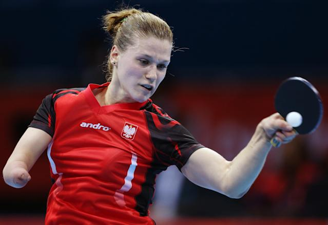 Natalia Partyka of Poland, competes against Li Jie of the Netherlands during their women's table tennis match at the 2012 Summer Olympics, Sunday, July 29, 2012, in London. (AP Photo/Sergei Grits)