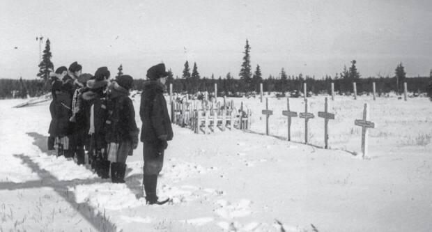 In this photo presented at the Truth and Reconciliation Commision, residential school students are seen at the Roman Catholic cemetery in Fort George, Que. Fort George was home to the province's first residential schools. ( Truth and Reconciliation Commission/Deschâtelets Archives - image credit)