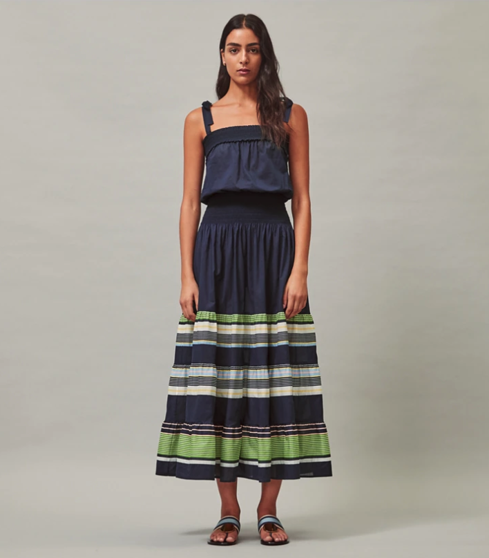 """<p><strong>Tory Burch</strong></p><p>toryburch.com</p><p><strong>$309.00</strong></p><p><a href=""""https://go.redirectingat.com?id=74968X1596630&url=https%3A%2F%2Fwww.toryburch.com%2Fsmocked-sundress%2F57094.html&sref=https%3A%2F%2Fwww.townandcountrymag.com%2Fstyle%2Ffashion-trends%2Fg36755206%2Ftory-burchs-semi-annual-sale-june-2021%2F"""" rel=""""nofollow noopener"""" target=""""_blank"""" data-ylk=""""slk:Shop Now"""" class=""""link rapid-noclick-resp"""">Shop Now</a></p><p><strong><del>$448</del> $150 (66% off)</strong></p><p>This easy, breezy frock will be your go-to choice for those hot, dog days of summer.</p>"""