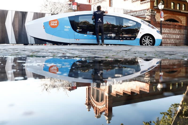 A student from Eindhoven's Technical University cleans Stella Vita vehicle in Spain
