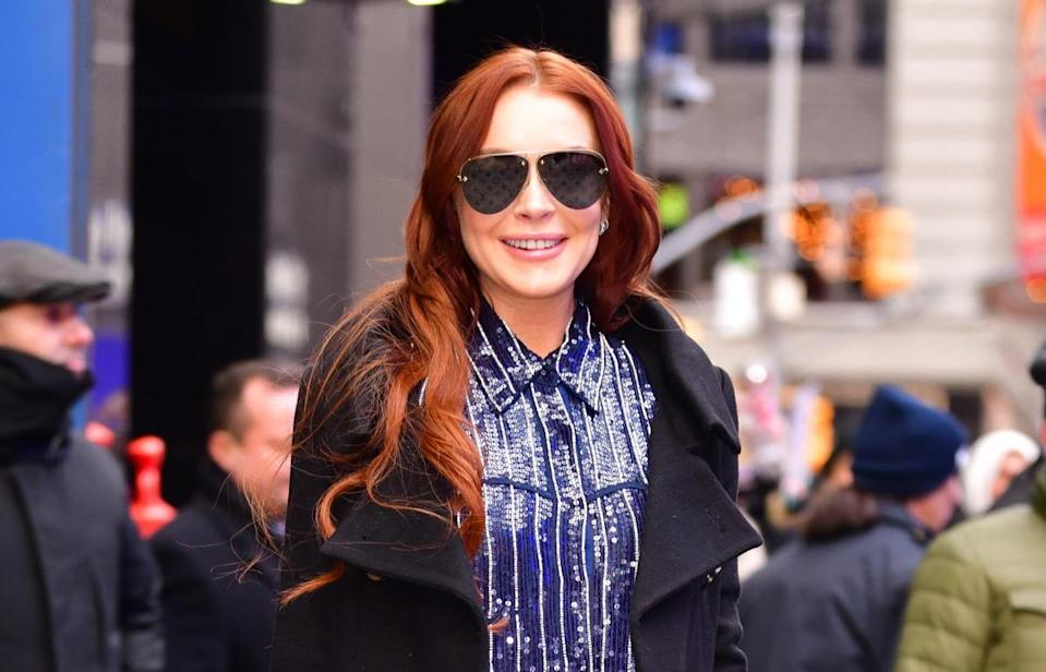 """NEW YORK, NY - JANUARY 07:  Lindsay Lohan leaves ABC's """"Good Morning America"""" in Times Square on January 7, 2019 in New York City.  (Photo by James Devaney/GC Images)"""