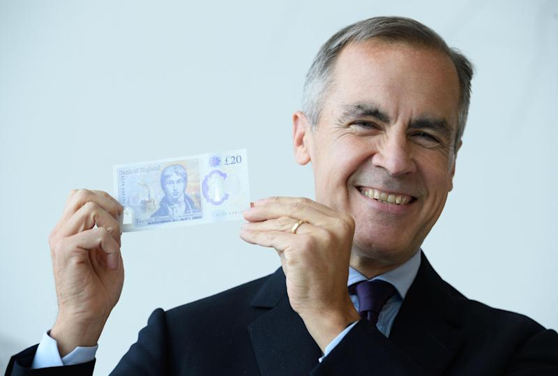 Mark Carney holds up a new £20 note featuring JMW Turner: Leon Neal/Getty Images