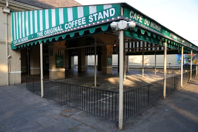 FILE PHOTO: An empty view of the 24-hour French Quarter restaurant Cafe Du Monde amid the outbreak of the coronavirus disease (COVID-19), in New Orleans