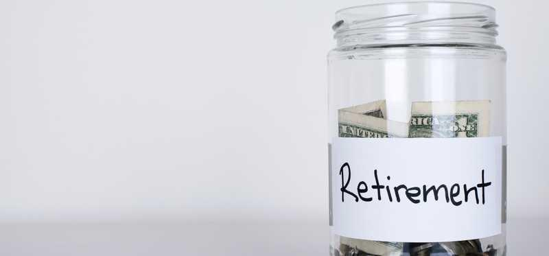 Glass jar with money labeled Retirement.