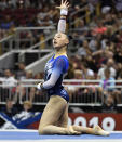 FILE - Emily Lee performs her floor routine during the GK US Classic gymnastics meet in Louisville, Ky., in this Saturday, July 20, 2019, file photo. Lee is among the 18 women competing at the 2021 U.S. Olympic Trials in St. Louis starting on Friday night, June 25.(AP Photo/Timothy D. Easley, File)