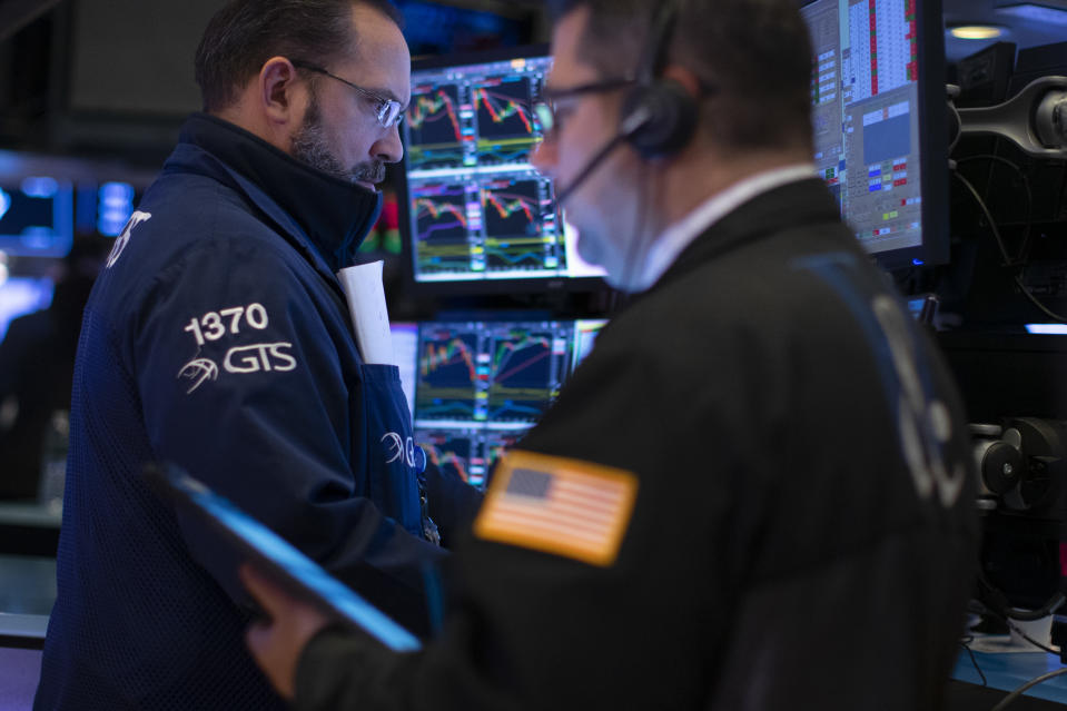 NEW YORK, NY - JANUARY 10: Traders work on the floor of the New York Stock Exchange (NYSE) on January 10, 2020 in New York City. Amid new sanctions on Iran and 145k more U.S. jobs added and wage growth in December, the Dow topped the 29,000 milestone before pulling back to 28,823.77. (Photo by Kena Betancur/Getty Images)