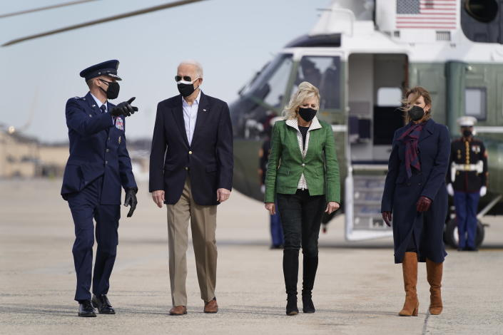 President Joe Biden and first lady Jill Biden walk to board Air Force One at Andrews Air Force Base, Md., Friday, Feb. 26, 2021. They are en route to Houston to survey damage caused by severe winter weather and encourage people to get their coronavirus shots. (AP Photo/Patrick Semansky)