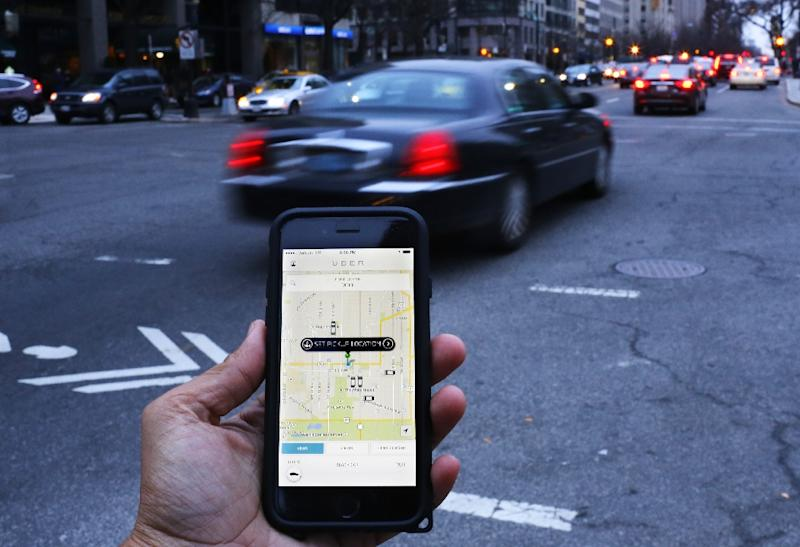 Car-hailing app Uber admitted that hackers stole the personal data of 57 million riders and drivers (AFP Photo/Andrew Caballero-Reynolds)