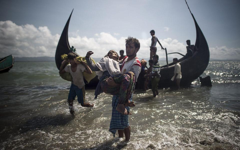 Myanmar's military attacked Rohingya Muslims, forcing them to flee their homeland and into Bangladesh - FRED DUFOUR/AFP via Getty Images