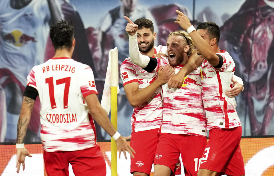 Leipzig's Emil Forsberg, second right, celebrates with teammates after scoring his sides second goal during the German Bundesliga soccer match between RB Leipzig and VfB Stuttgart in Leipzig, Germany, Friday, Aug. 20, 2021. (AP Photo/Michael Sohn)