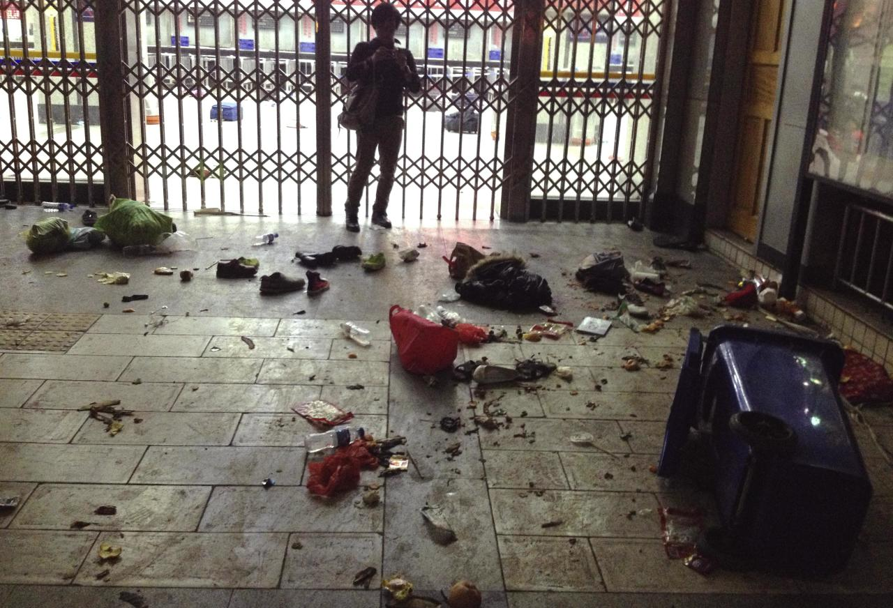 In this March 1, 2014 photo provided by China's Xinhua News Agency, scattered luggage are seen inside the Kunming Railway Station in Kunming, capital of southwest China's Yunnan Province. More than 10 assailants slashed scores of people with knives at the train station in southern China in what officials said Sunday was a terrorist assault by ethnic separatists from the far west. Twenty-nine slash victims and four attackers were killed and 143 people wounded. (AP Photo/Xinhua, Lin Yiguang) NO SALES