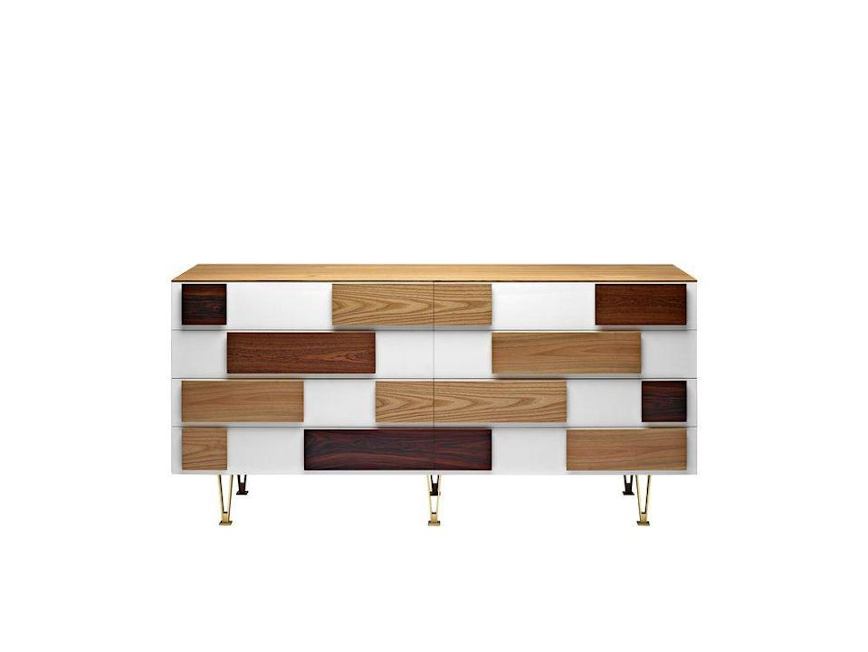 """<p>Recreated from drawings found in the Gio Ponti archives and now manufactured by <a href=""""https://www.molteni.it/en/"""" rel=""""nofollow noopener"""" target=""""_blank"""" data-ylk=""""slk:Molteni & C"""" class=""""link rapid-noclick-resp"""">Molteni & C</a>, the 'D.655.1' and 'D.655.2' sideboards were designed in the period between 1952 and 1955. Handles are made from a selection of beautiful timbers, including walnut, rosewood and elm.</p><p><strong>Like this article? </strong><u><a href=""""https://hearst.emsecure.net/optiext/optiextension.dll?ID=LKHLy4U%2BAPDM5JcrmOKxtYntAlN0FMNelBSKJmXANeFj7b3wVEXa8UQNxN3Kk5RyF_0Q89Kyk6%2BjLh"""" rel=""""nofollow noopener"""" target=""""_blank"""" data-ylk=""""slk:Sign up to our newsletter"""" class=""""link rapid-noclick-resp"""">Sign up to our newsletter</a></u> to get more articles like this delivered straight to your inbox.</p><p><strong><strong><strong><a class=""""link rapid-noclick-resp"""" href=""""https://hearst.emsecure.net/optiext/optiextension.dll?ID=LKHLy4U%2BAPDM5JcrmOKxtYntAlN0FMNelBSKJmXANeFj7b3wVEXa8UQNxN3Kk5RyF_0Q89Kyk6%2BjLh"""" rel=""""nofollow noopener"""" target=""""_blank"""" data-ylk=""""slk:SIGN UP"""">SIGN UP</a></strong></strong></strong></p><p><strong>Keep your spirits up </strong>and <a href=""""https://www.hearstmagazines.co.uk/elle-decoration-magazine-subscription-website?utm_source=elledecoration.co.uk&utm_medium=referral&utm_content=stayathome"""" rel=""""nofollow noopener"""" target=""""_blank"""" data-ylk=""""slk:subscribe to ELLE Decoration here"""" class=""""link rapid-noclick-resp"""">subscribe to ELLE Decoration here</a>, so our magazine is delivered direct to your door.</p>"""