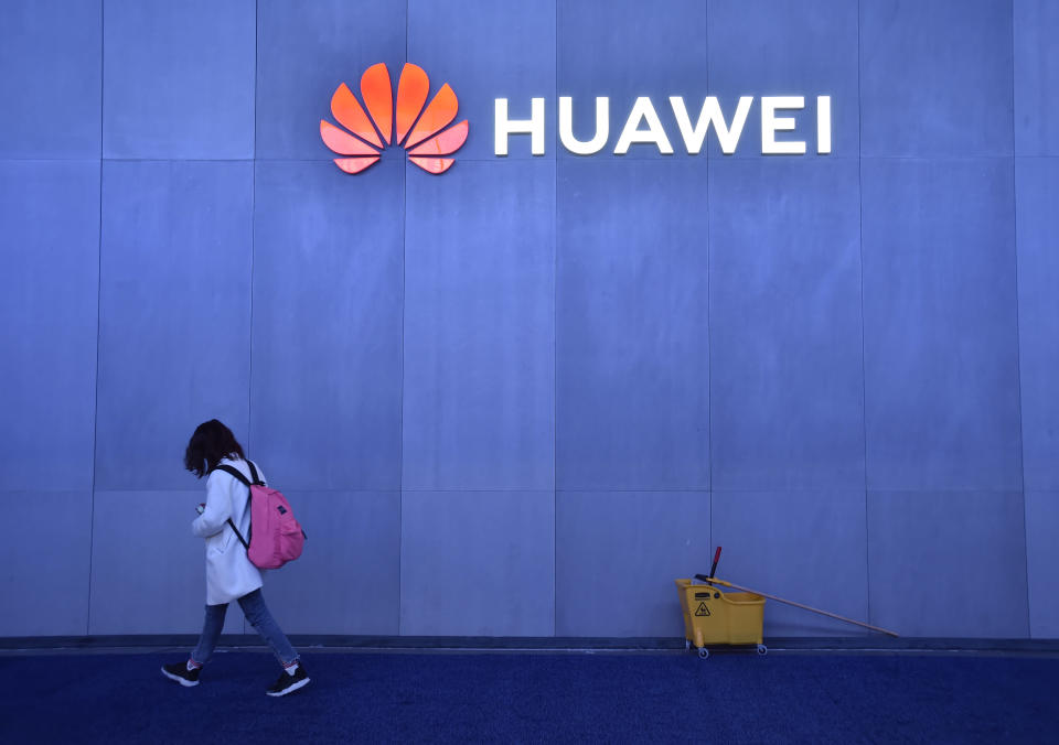 LAS VEGAS, NEVADA - JANUARY 08: An attendee walk by the Huawei booth at CES 2019 at the Las Vegas Convention Center on January 8, 2019 in Las Vegas, Nevada. CES, the world's largest annual consumer technology trade show, runs through January 11 and features about 4,500 exhibitors showing off their latest products and services to more than 180,000 attendees. (Photo by David Becker/Getty Images)