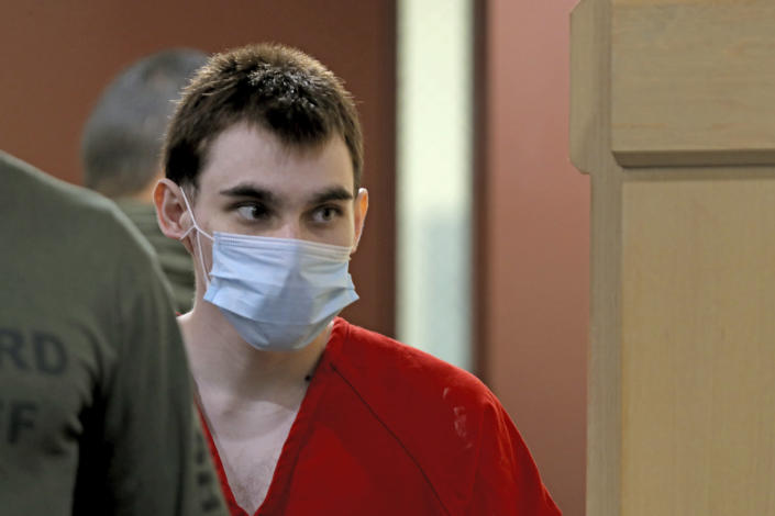 Parkland school shooter Nikolas Cruz is escorted into the courtroom for a pre-trial hearing at the Broward County Courthouse in Fort Lauderdale, Fla., Wednesday, July 14, 2021, on four criminal counts stemming from his alleged attack on a Broward jail guard in November 2018. Cruz is accused of punching Sgt. Ray Beltran, wrestling him to the ground and taking his stun gun. (Amy Beth Bennett/South Florida Sun-Sentinel via AP, Pool)