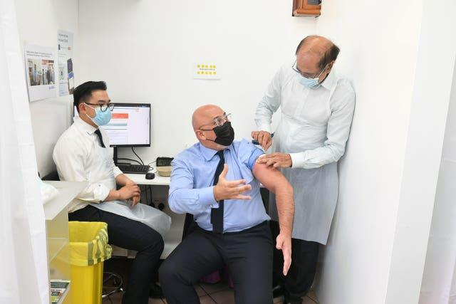 Nadhim Zahawi, while Vaccines Minister, receives his second dose of the Covid-19 vaccination (Dominic Lipinski/PA)