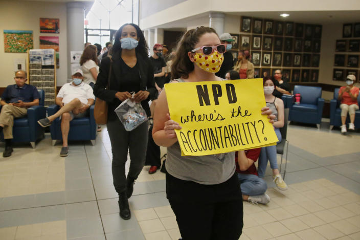 Protesters arrive at a Norman City Council meeting on June 9, 2020, to present a list of demands to the council which included defunding the police. (Sue Ogrocki / AP file)
