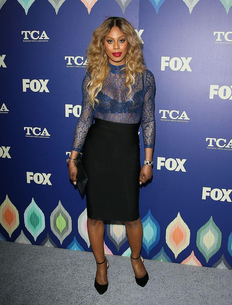<p>Working it in a black pencil skirt and sheer lace top. <i>(Photo by JB Lacroix/WireImage)</i></p>