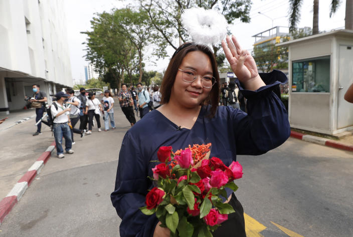 A pro-democracy activist, Panusaya Sithijirawattanakul, gestures with a three-fingers salute, a symbol of resistance as she arrived at the Attorney General office in Bangkok, Thailand, Monday, March 8, 2021. Prosecutors in Thailand charged 18 pro-democracy activists with sedition on Monday, while lodging additional charges of insulting the monarchy against three of them. (AP Photo/Sakchai Lalit)