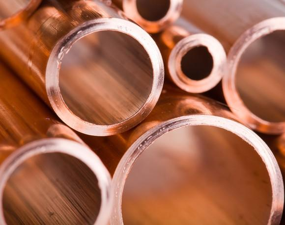 A pile of copper pipes