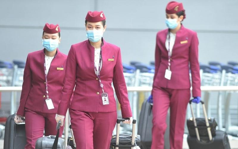 Cabin crew wearing masks at Manchester Airport yesterday - CHRIS NEILL