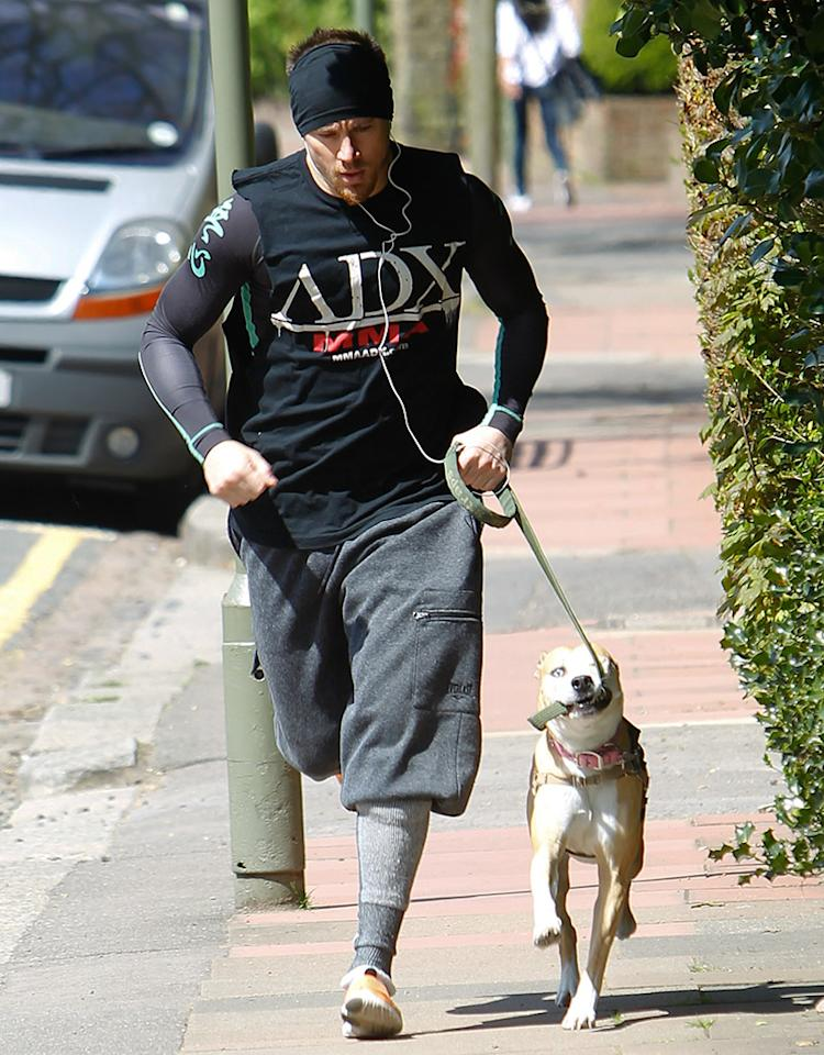 Actor Channing Tatum is seen jogging with his pet dog in London (Picture taken April 30, 2013)