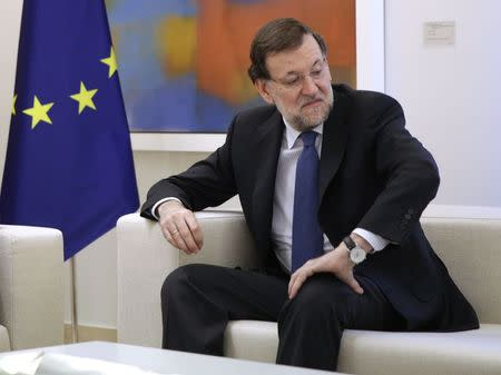 Spain's Prime Minister Mariano Rajoy reacts during a meeting with Panama's outgoing President Ricardo Martinelli at the Palace of Moncloa in Madrid