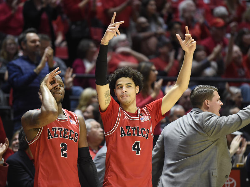 San Diego State guard Adam Seiko (2) and guard Trey Pulliam (4) celebrate during the second half of an NCAA college basketball game against Nevada, Saturday, Jan. 18, 2020, in San Diego. (AP Photo/Denis Poroy)