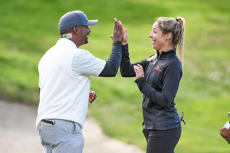Alfonso Ribeiro and Kira Kazantsev high five on the 18th hole during the first round of the 2019 AT&T Pebble Beach Pro-Am.