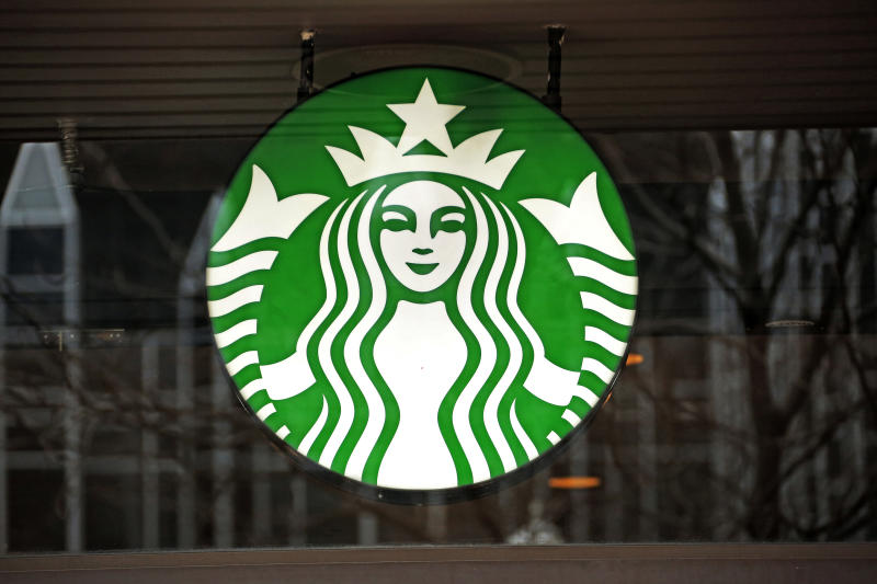 FILE - This Thursday, Jan. 12, 2017, file photo shows the sign in the window of a Starbucks in Pittsburgh. On Tuesday, May 16, 2017, some Starbucks customers said on social media that they got free drinks because of an outage of the chain's registers. The company said the outage was the result of an overnight technology update. (AP Photo/Gene J. Puskar, File)