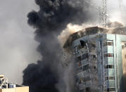 The building housing the offices of The Associated Press and other media in Gaza City collapses after it was hit by an Israeli airstrike Saturday, May 15, 2021. The attack came roughly an hour after the Israeli military warned people to evacuate the building, which also housed Al-Jazeera and a number of offices and apartments. There was no immediate explanation for why the building was targeted. (AP Photo/Hatem Moussa)