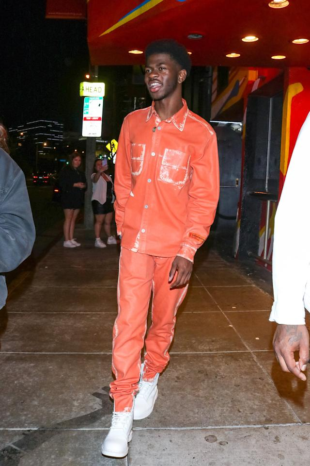 <p>Lil Nas X brightened up our day in an orange denim-inspired set and white sneakers.</p>