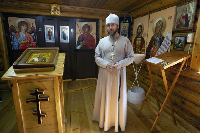 Russian Orthodox priest father Vladimir stands inside a church at the Russian naval facility in Tartus, Syria, on patrol in eastern Mediterranean, Thursday, Sept. 26, 2019. Russia has a naval base in Tartus, the only such facility it has outside the former Soviet Union. (AP Photo/Alexander Zemlianichenko)