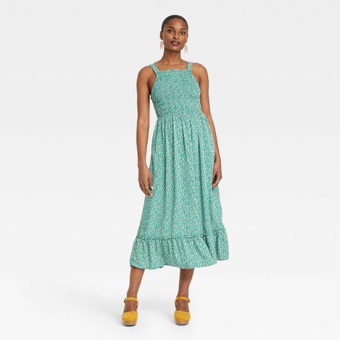 <p>This <span>Universal Thread Sleeveless Smocked Strappy Dress</span> ($30) is a must have for those dog days of summer. But once the temperature drops, you can slip a turtleneck underneath or throw on a jean jacket.</p>